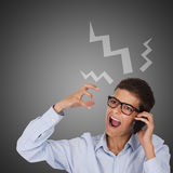 Man talking by phone and screaming. Man screaming on the mobile phone Stock Photography
