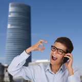 Man talking by phone and screaming. In the street Stock Photos