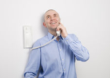 Man talking on a phone and smiling Royalty Free Stock Photos