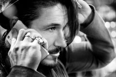 Man talking on the phone on the street. Black and white photo.  Royalty Free Stock Photography