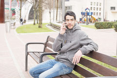 Man talking on the phone in the street. Stock Photo