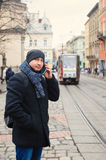 Man talking on the phone in the winter Royalty Free Stock Image