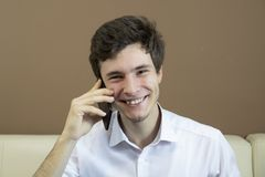 Man is talking on the smartphone. stock images