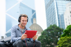 Man talking on tablet pc - Video chat conversation. Man talking on tablet pc having video chat conversation in sitting outside using app on 4g wireless device Stock Image
