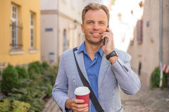 Man talking on the telephone. And smiling Stock Image