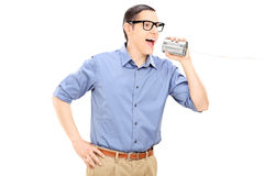 Man talking through a tin can phone Royalty Free Stock Photo
