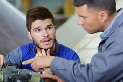Man talking to apprentice. Male royalty free stock photography