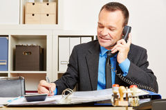 Man talking to customer support hotline on the phone royalty free stock photography