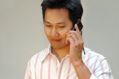 Man talking to the handphone. Side view Stock Photos