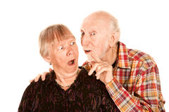 Man talking to shocked wife Stock Photography