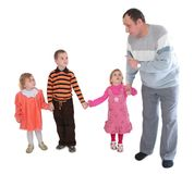 Man talking to three kids Royalty Free Stock Photo