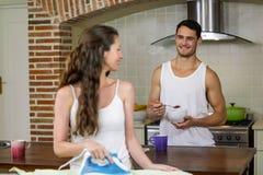Man talking to woman while having breakfast royalty free stock photo