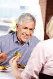 Man talking to woman in restaurant Stock Photo
