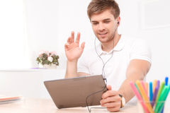 Man talking via skype on the tablet stock photos