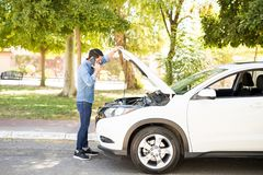 Free Man Talking With Car Mechanic On Road Stock Image - 122124981