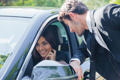 Free Man Talking With Woman In Car Royalty Free Stock Images - 58517359