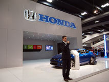 Man talks about Honda cars at booth Royalty Free Stock Images