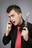 Man talks by a mobile phone Royalty Free Stock Images