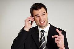 Man talks into mobile phone Stock Photos