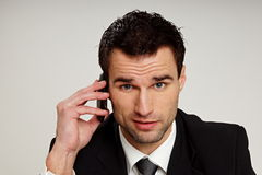 Man talks into mobile phone. Royalty Free Stock Photography