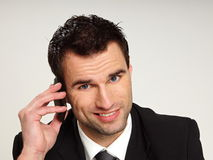 Man talks into mobile phone. royalty free stock photos
