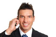 Man talks into mobile phone Stock Photo