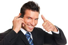 Man talks into mobile phone royalty free stock images