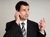 Man talks into mobile phone Stock Photography