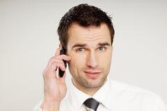 Man talks into mobile phone. stock photos