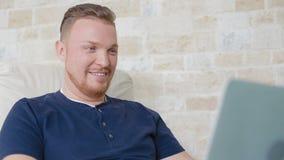 The man talks on Skype on the laptop