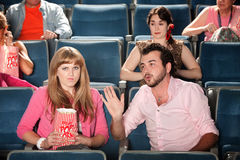 Man Talks to Woman in Theater Royalty Free Stock Photography