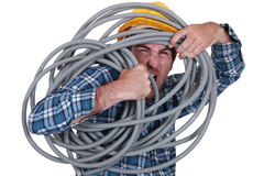 Man tangled in cable Stock Photos