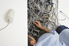 Man With Tangled Computer Wires Stock Photography