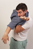 Man tangled in his shirt Royalty Free Stock Photo