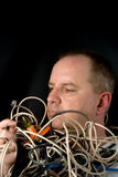 Man Tangled in Wires Stock Photos