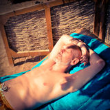 Man Tanning on the Beach Royalty Free Stock Photography