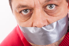 Man with tape gagged mouth Stock Photos