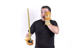 Man with a tape measure. Expressive man with a tape measure isolated on white Stock Photos