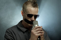 Man With Tape And Microphone Stock Image