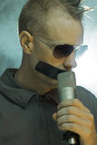 Man With Tape And Microphone Stock Photo