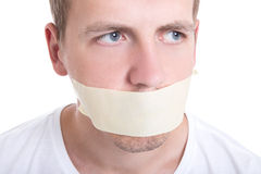 Man with tape over his mouth isolated on white Royalty Free Stock Image