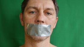 Man with taped mouth. stock video footage