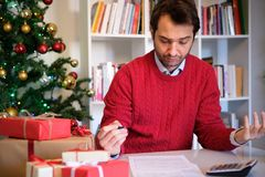 Man tapped out and without money for christmas gifts Royalty Free Stock Images