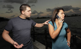 Man tapping womans shoulder Stock Photos