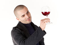 Man taste wine. Young man with glass of red win Stock Photography