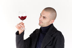 Man taste wine. Young man with glass of red win Stock Image