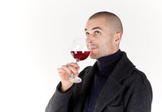 Man taste wine. Young man with glass of red win Royalty Free Stock Photography
