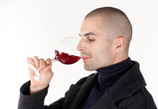 Man taste wine. Young man with glass of red win Stock Photo