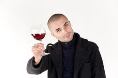 Man taste wine. Young man with glass of red win Royalty Free Stock Image