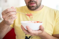 The man tastes strawberries yogurt, healthy food and lifestyle Stock Photography